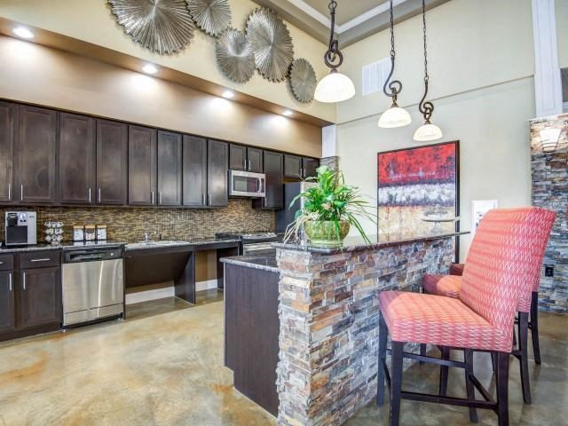 Chef Inspired Community Kitchen Islands with Chic Pendant Lighting at Maystone at Wakefield, Raleigh, NC