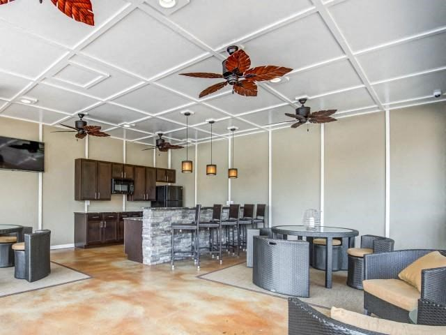 Summer Kitchen with TV Lounge at Maystone at Wakefield, Raleigh