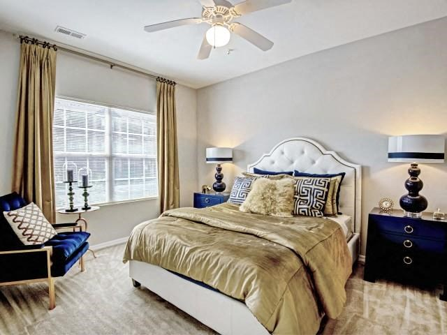 Bedroom With Lighted Ceiling Fan at Village at Town Center, North Carolina, 27616