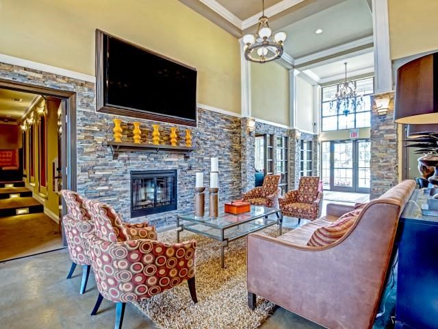 Clubhouse with TV, Kitchen and Fireplace at Village at Town Center, North Carolina