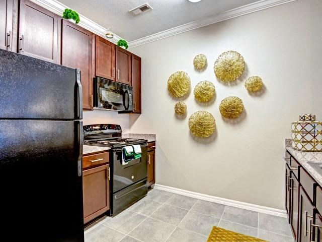Kitchen With Microwaves at Village at Town Center, Raleigh, NC