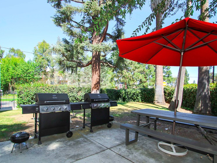 Barbecues and seating area adjacent to the private park.