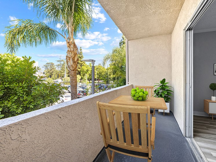 Large balcony with seating space and view of neighborhood of Chandler Circle Apartments.