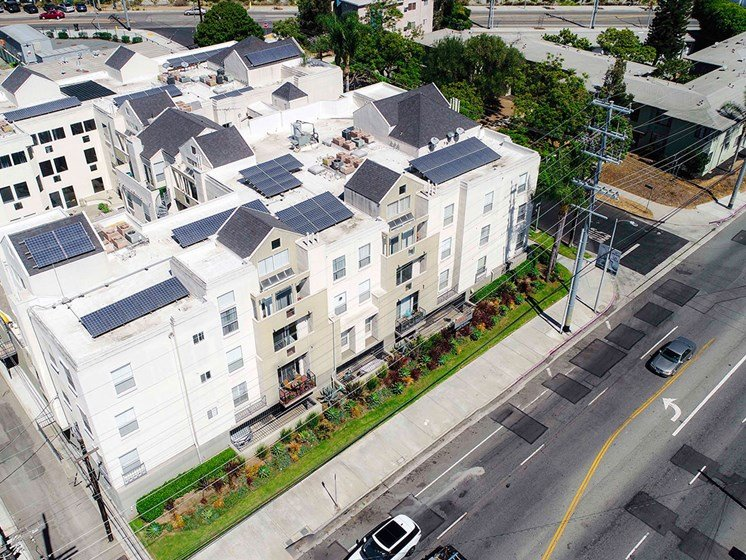 Aerial drone image off Palms Blvd showing solar panels and white roof.