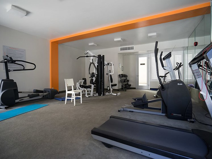 Fitness center with treadmills and weight equipment.
