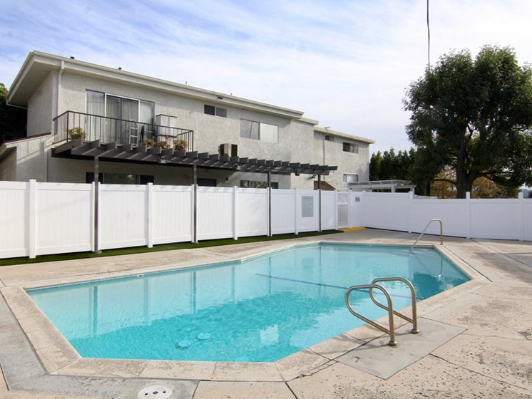 Cedar Glen's gated pool with lounging area.