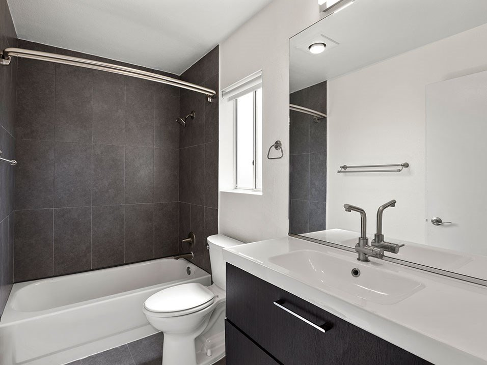 Modern styled bathroom with tub and shower.