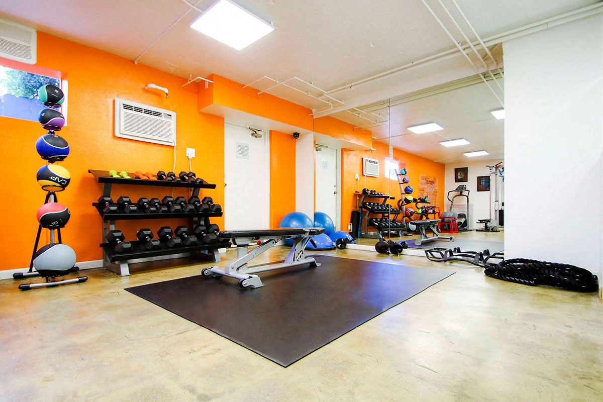 On-site gym with yoga space, medicine balls, and free weights.