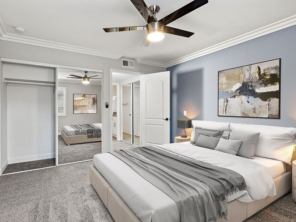 Large bedroom with ceiling fan.