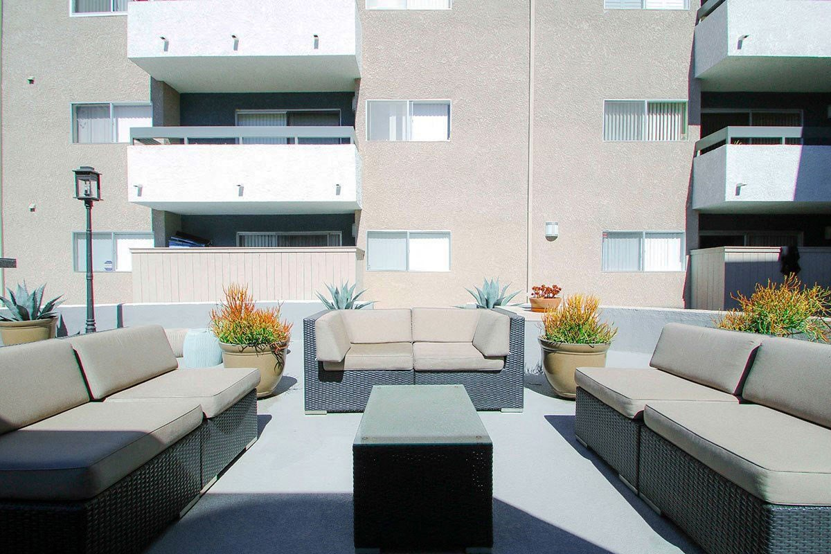 Community courtyard featuring barbecue and seating area.