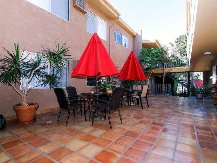 View of the courtyard with beautiful Spanish tile and community seating areas.