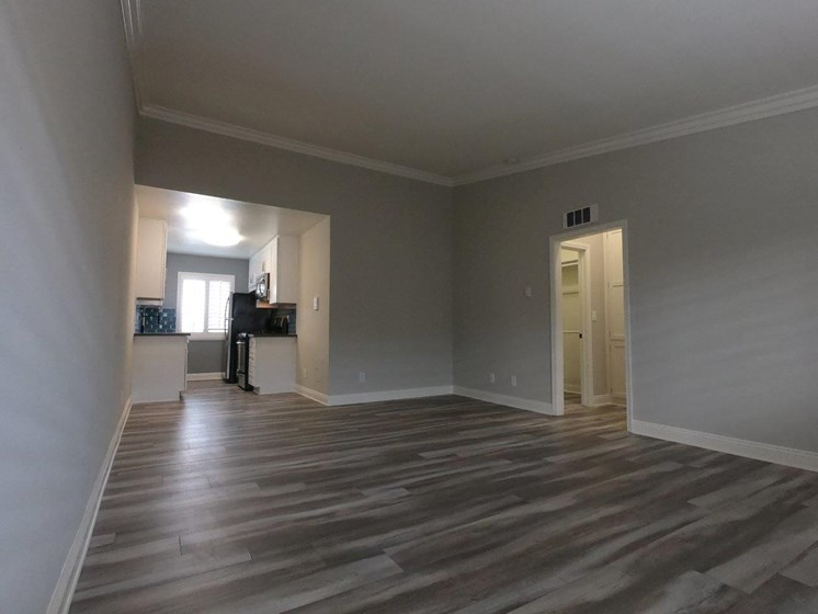 View of large living room which has hardwood laminate flooring.