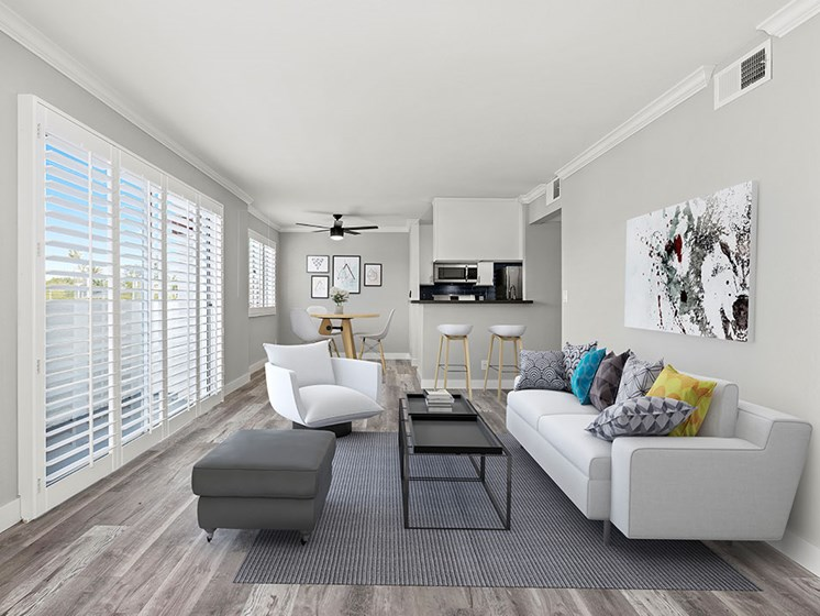 Living room with hardwood floor and large windows for natural light.