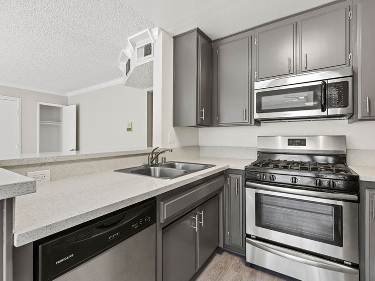 Kitchen with stainless steel oven, microwave, and dishwasher.