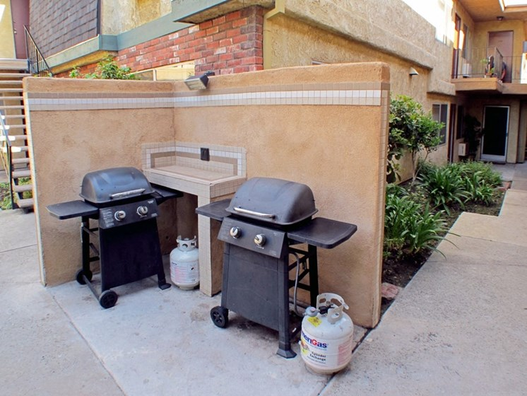 Community barbecue area with two barbeques.
