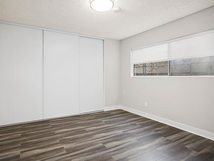 Hardwood floored bedroom with private closet.