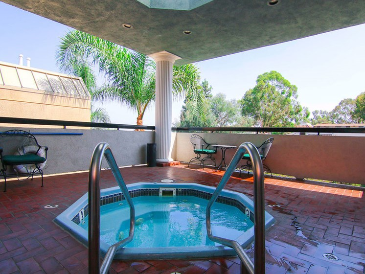 Relaxing jacuzzi with private view of neighborhood.