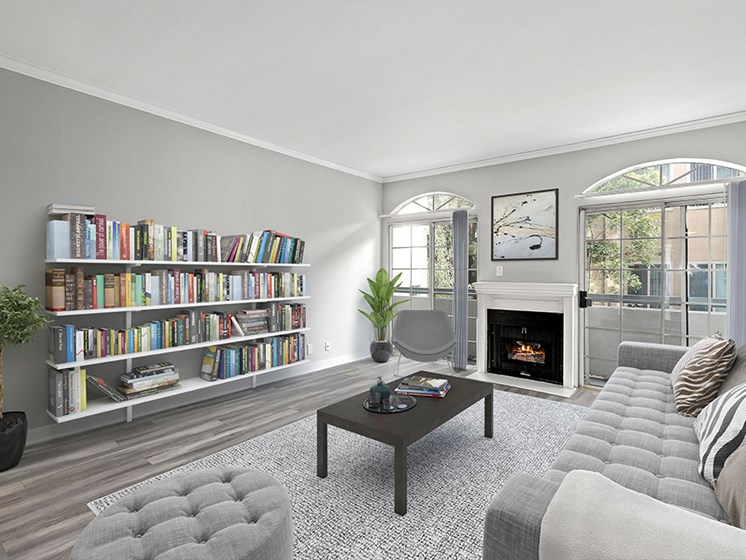 Large living room featuring hardwood floors and natural light providing adjacent patio.