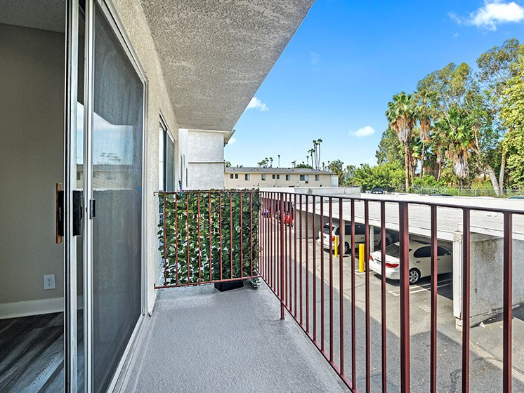Private balcony overlooking covered parking area.