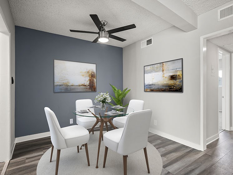 Hardwood floored dining area with celling fan.