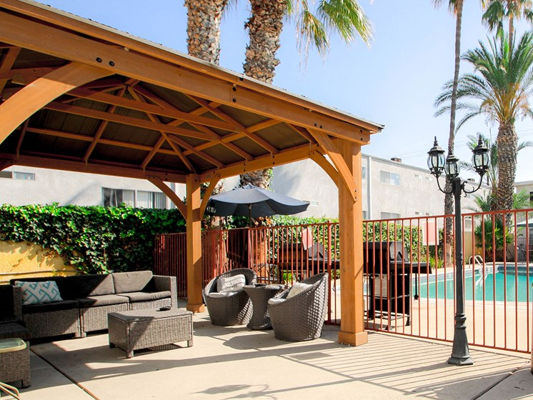 Gazebo and seating area by the pool.