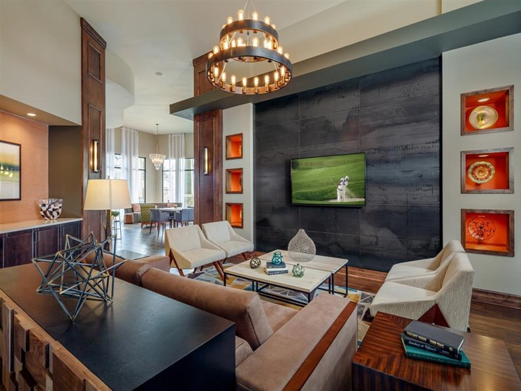 Resident clubhouse entrance with TV lounge area leading into business center and digital cafe