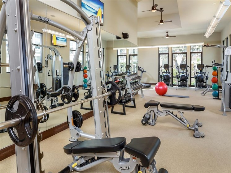 24hr Fitness Center with cardio machines, weight machines and free weights