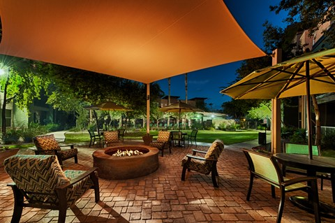 Fire pit at night with chairs surrounding it