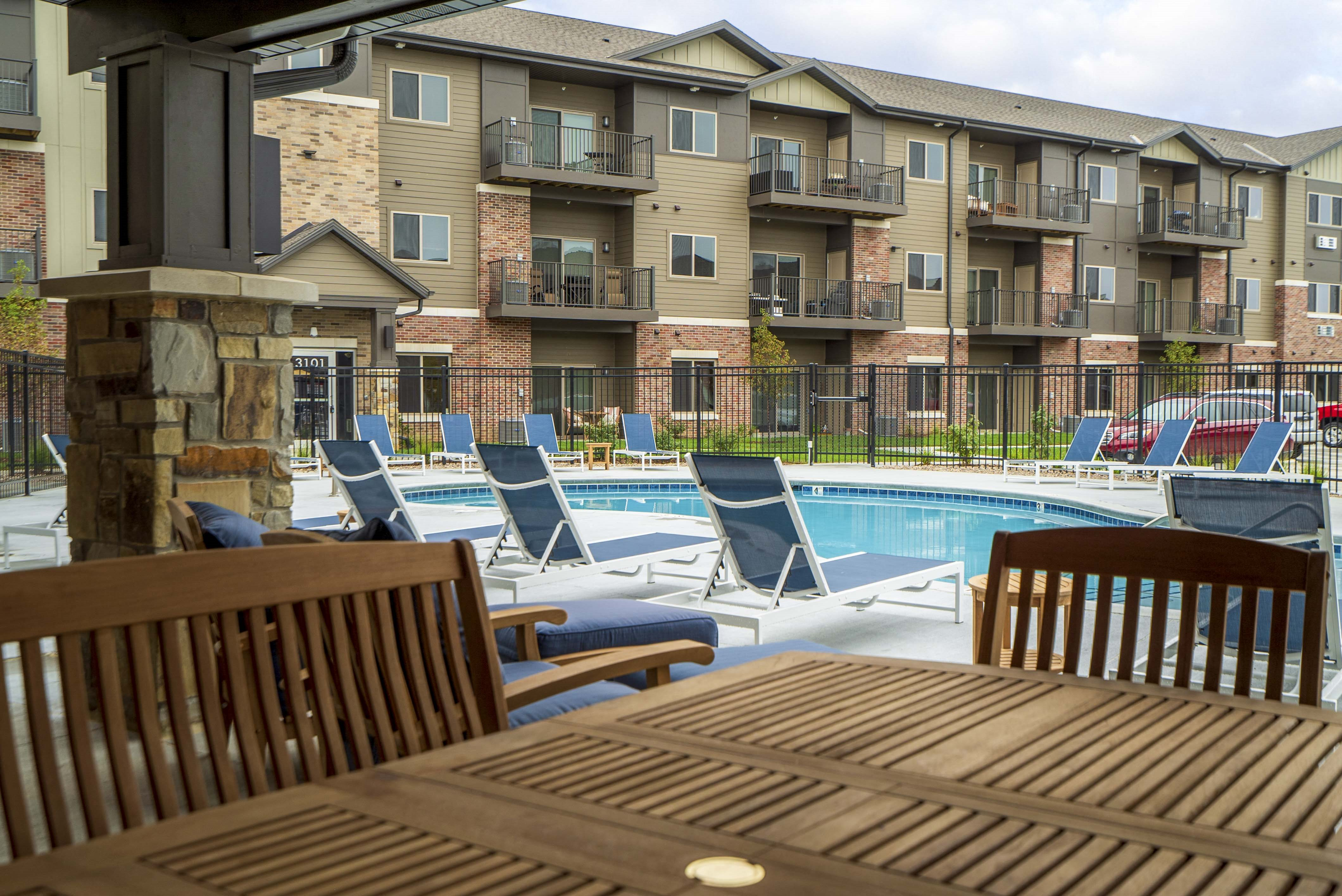 Exteriors - Relaxing patio, Luxury pool and hot tub view of WH Flats new luxury apartments in south Lincoln NE 68516