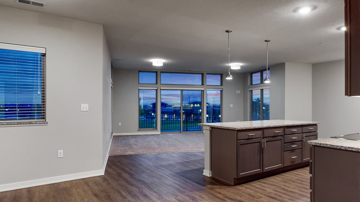 Large living space with floor to ceiling windows providing a great view at WH Flats