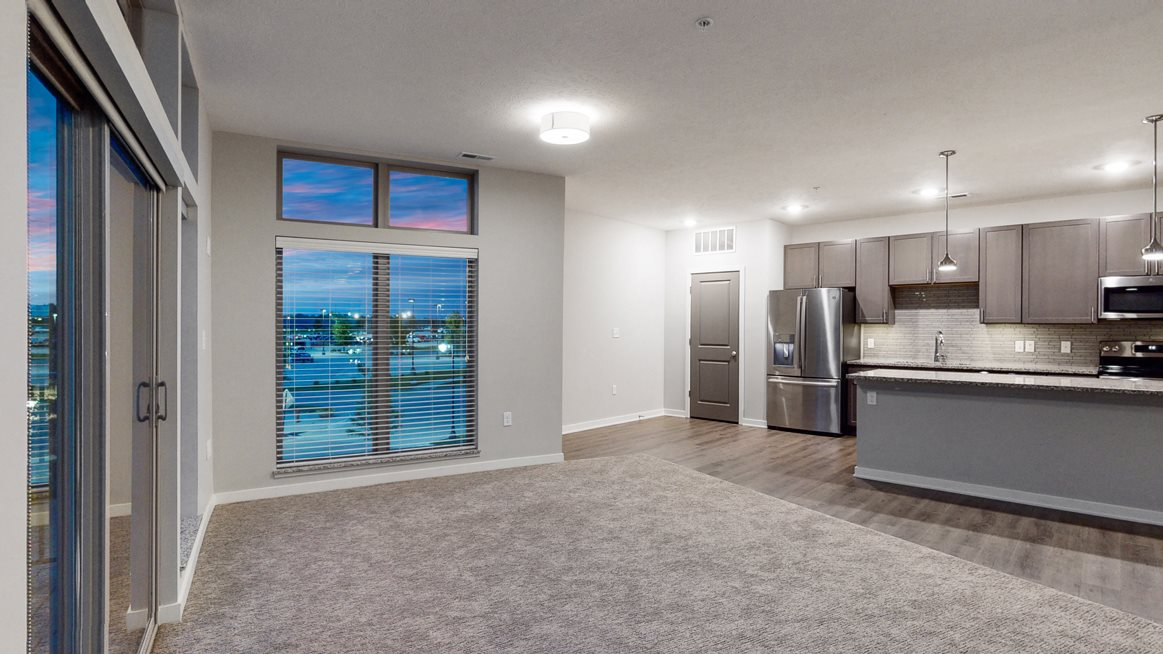 Open floor plan living space and kitchen at WH Flats