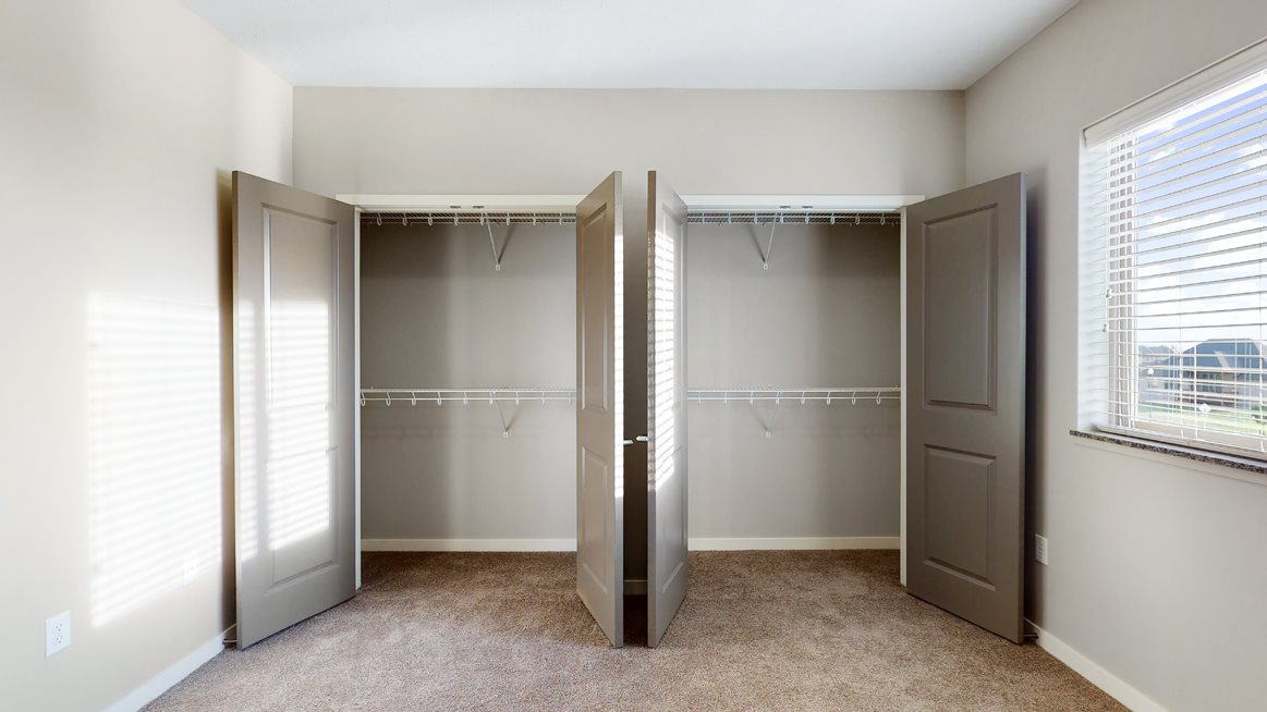 The 2 bedroom Marigold with den floor plan features incredibly spacious closets with abundant storage.