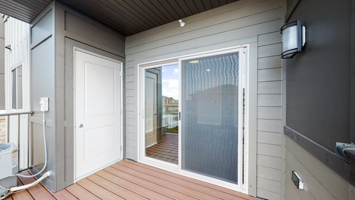 In the Marigold with den floor plan, enjoy the view from your spacious and patio.