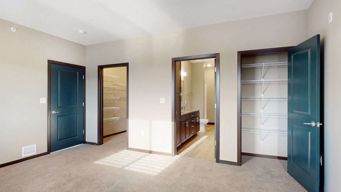 You'll love the large walk-in closet in the master bedroom of the Snowdrop with den floor plan at WH Flats.