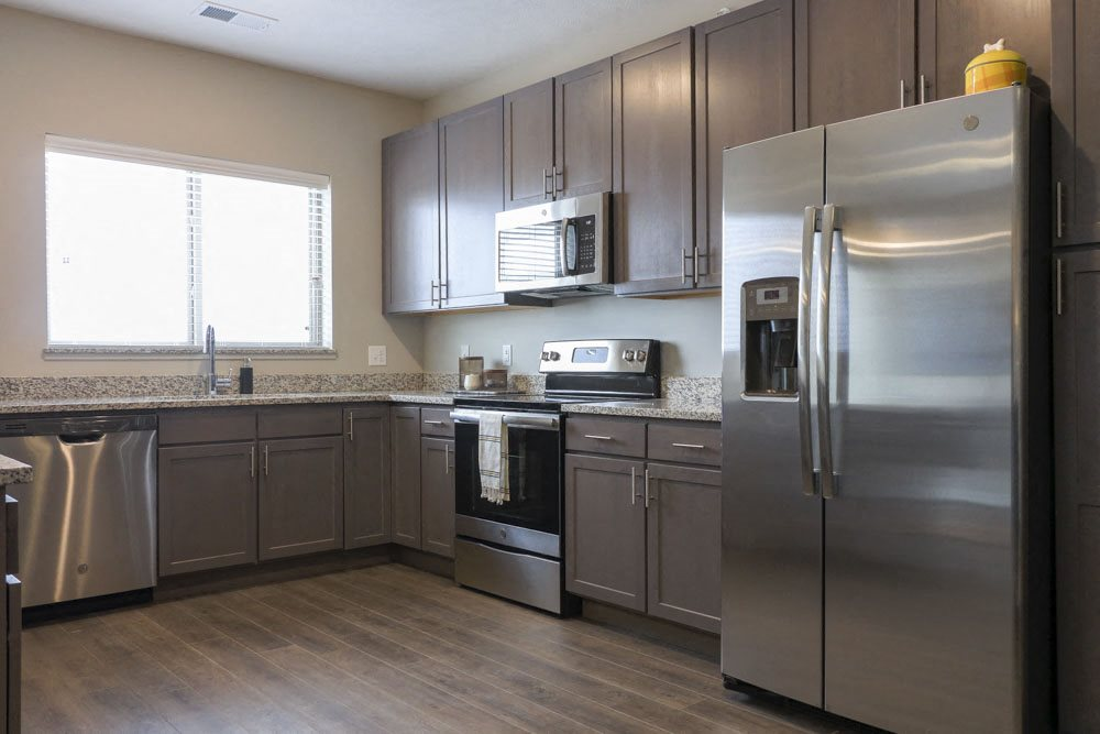 Open floor plan up to date kitchen at WH Flats