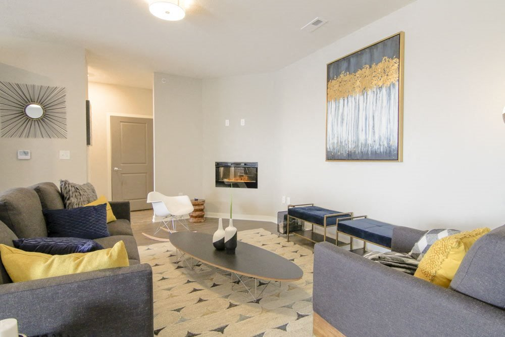 Living room with modern fireplace at WH Flats new luxury apartments in south Lincoln NE 68516