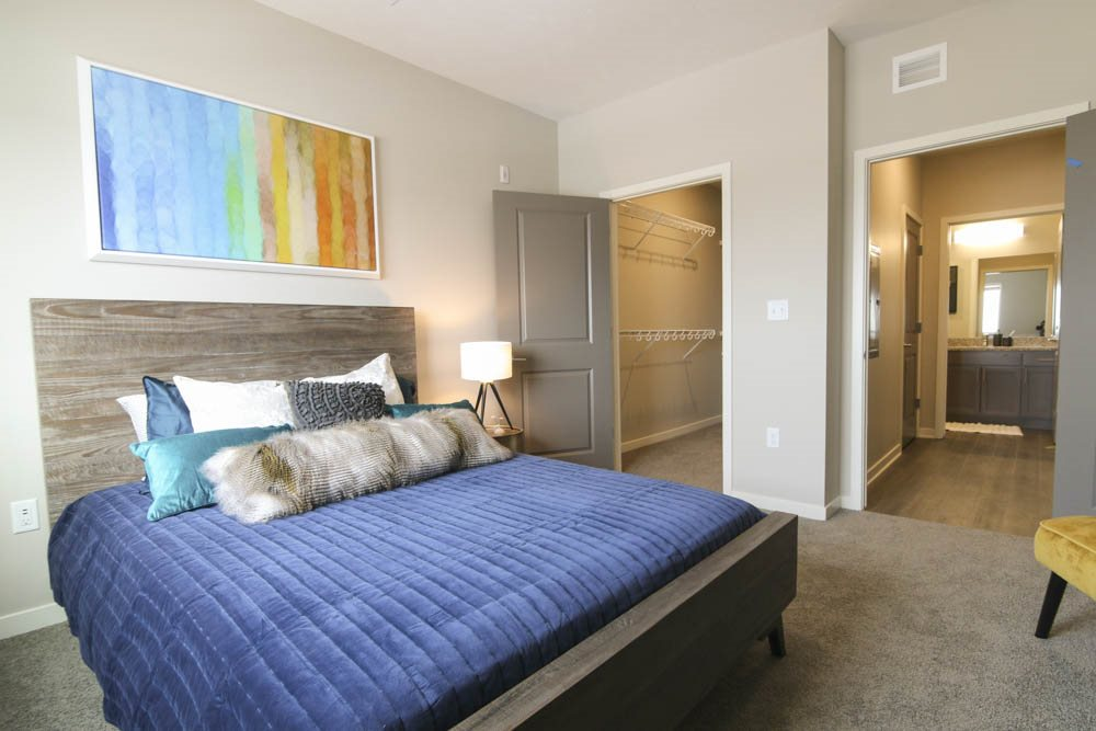 Bedroom with walk-in closet at WH Flats new luxury apartments in south Lincoln NE 68516