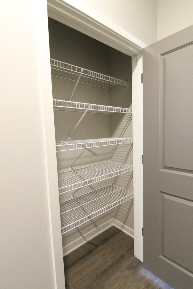 Spacious hallway closet with shelving at WH Flats new luxury apartments in south Lincoln NE 68516