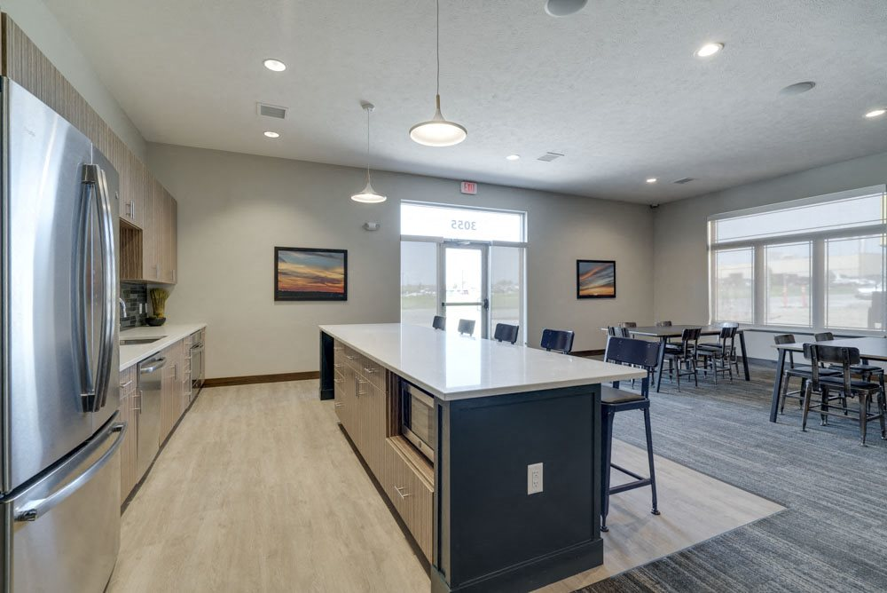 Resident clubhouse with kitchen and seating