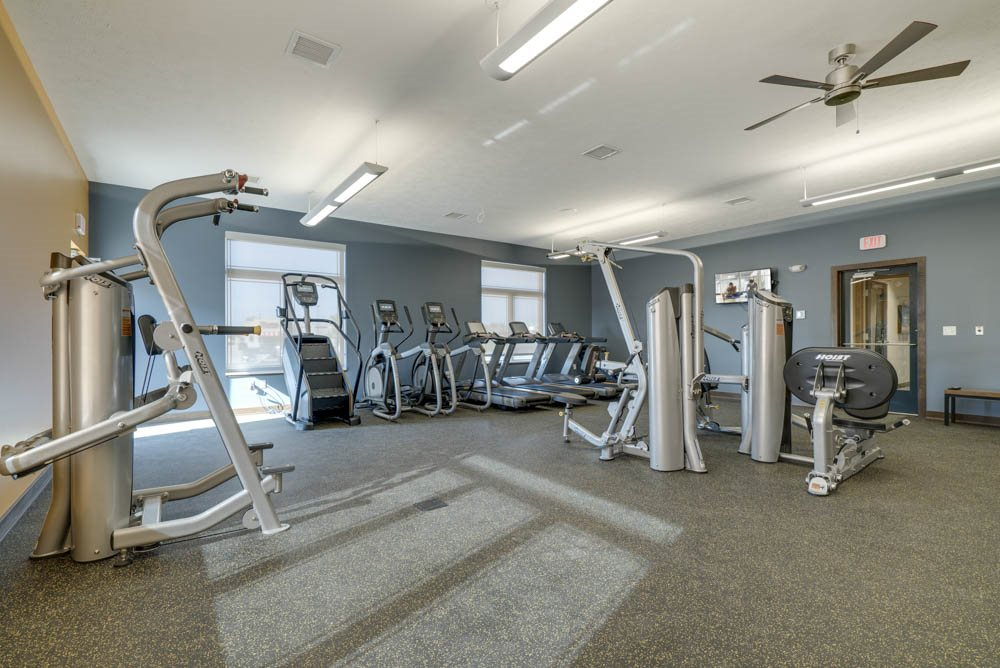 WH Flats apartments' expansive gym with cardio and weightlifting equipment in south Lincoln NE