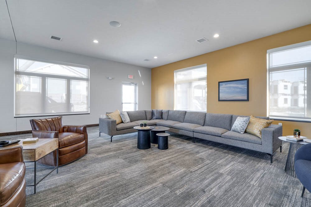 Clubhouse TV lounge with sofa and chairs at WH Flats luxury apartments in south Lincoln NE