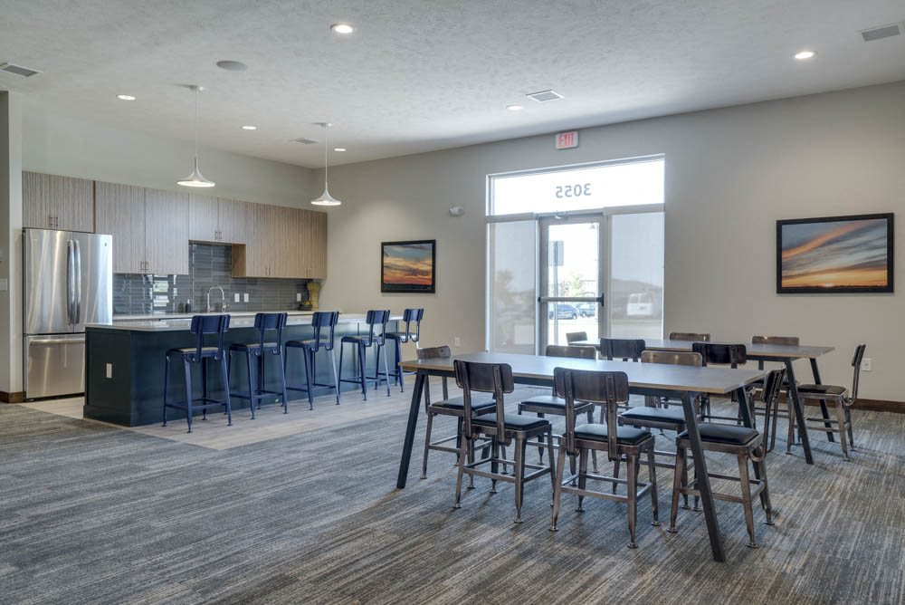 WH Flats luxury apartments clubhouse with kitchen and tables