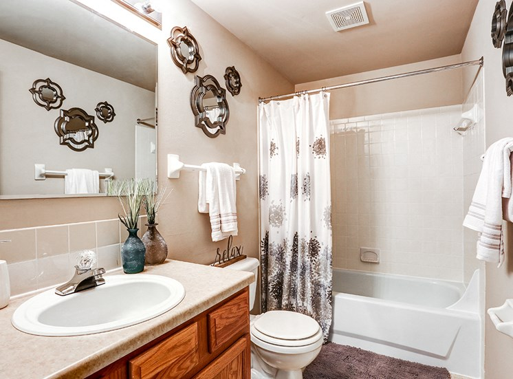 Bathroom at Archer's Pointe with vanity, toilet, and shower.