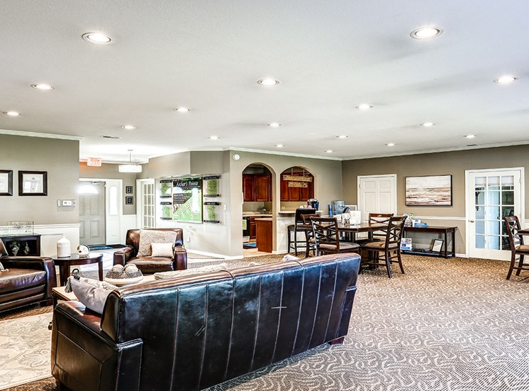 Renovated Clubhouse at Archer's Pointe with numerous seating options. The clubhouse offers a resident kitchen and hangout area.