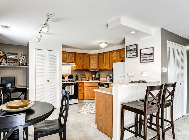 Kitchen at Archer's Pointe with oven, dishwasher, refrigerator, and pantry.