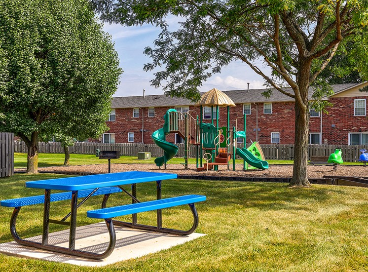 Playground at Archer's Pointe with slide and obstacle equipment for children.