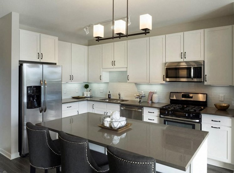 Kitchen Bar With Granite Counter Top Residences at 1700 Model Kitchen