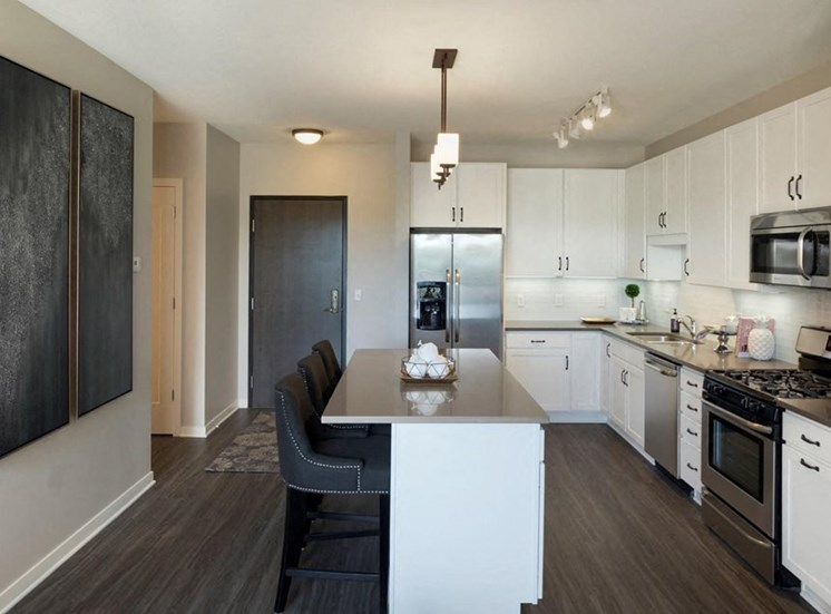 Kitchen With White Cabinetry And Black Appliances Residences at 1700, Minnetonka
