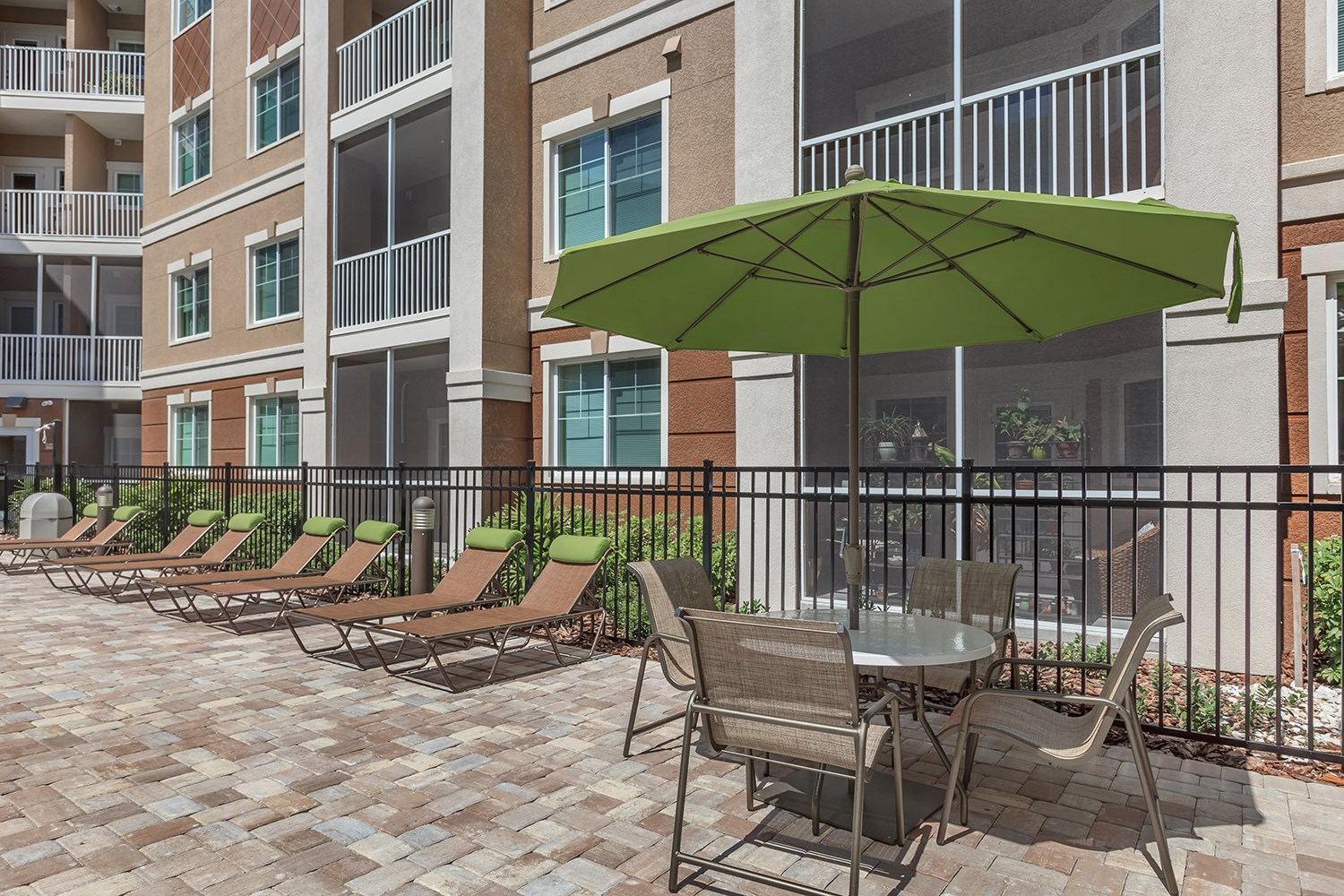 Poolside Lounges at Riversong Apartments in Bradenton, FL