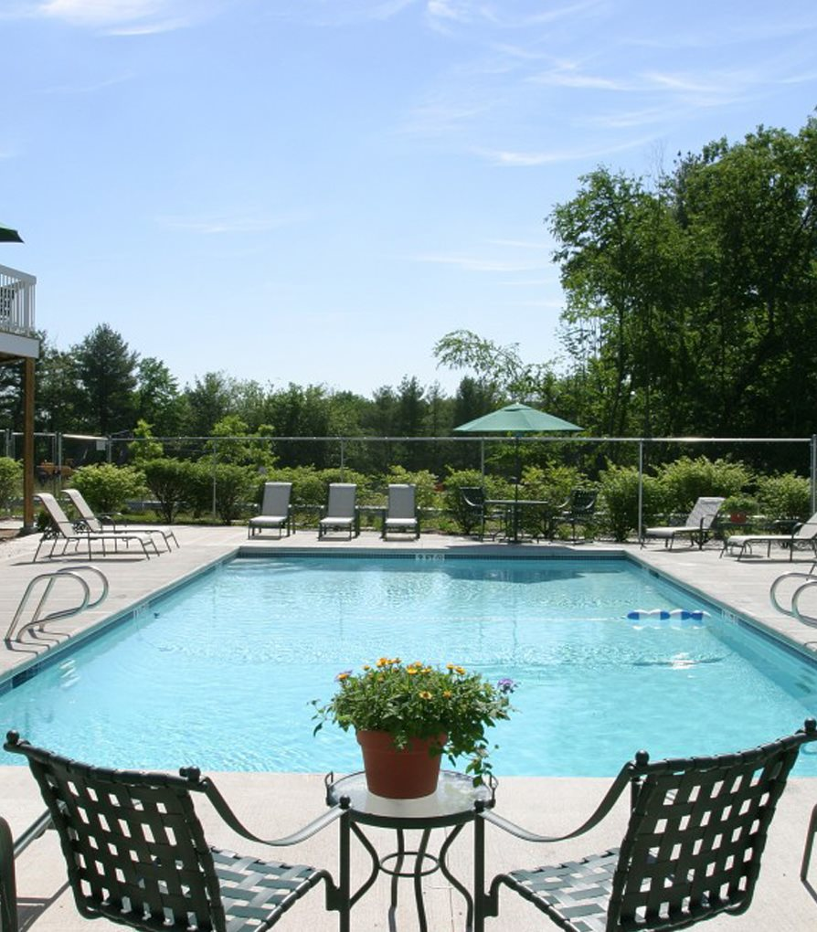Outdoor pool with lounging chairs at Windsor Terrace, Hooksett, NH, 03106
